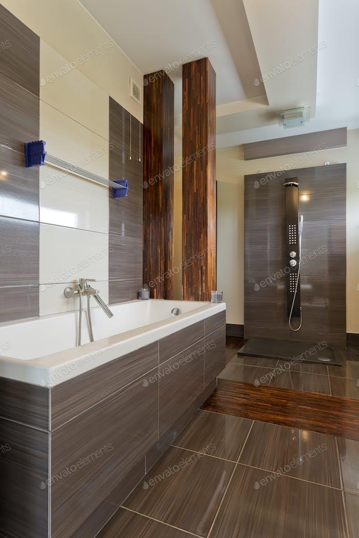 Stylish bathroom with big bathtub