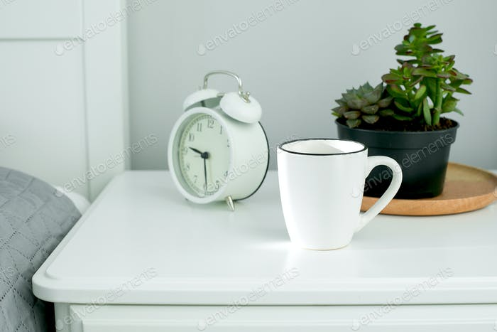 Placeit. Mockup concept. Empty Cup of coffee, alarm clock