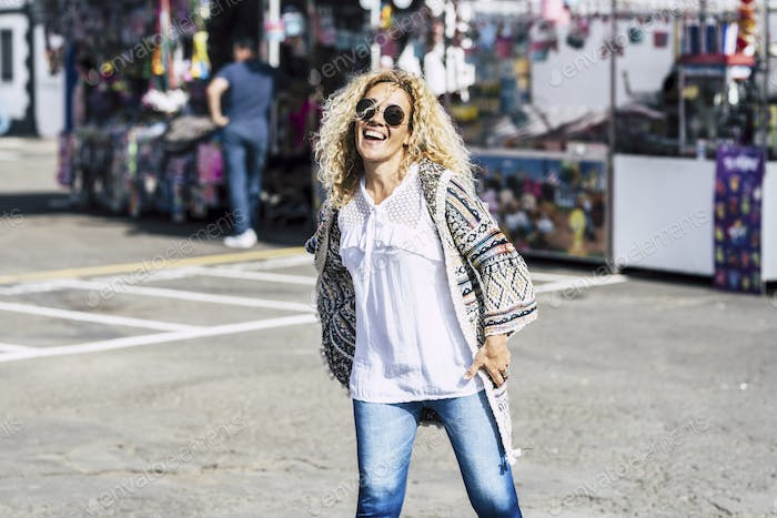 Cheerful happy young beautiful woman enjoy the flea market