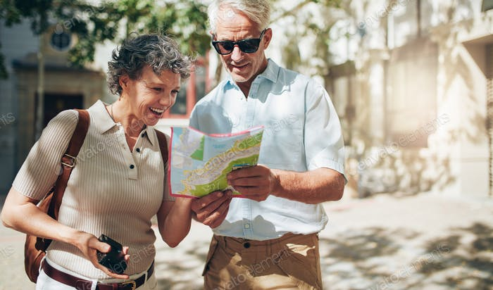 Senior couple reading a tourist map