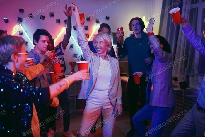 Mature woman having fun at the party