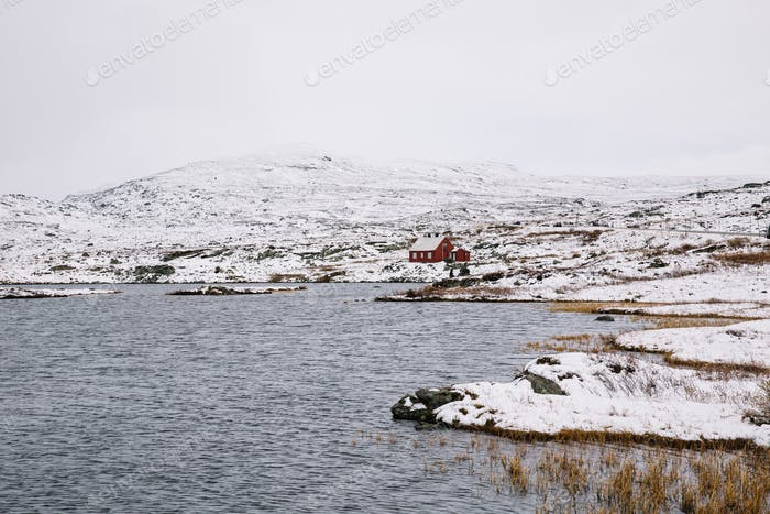 Norwegian Red Cottage surrounded by Snow