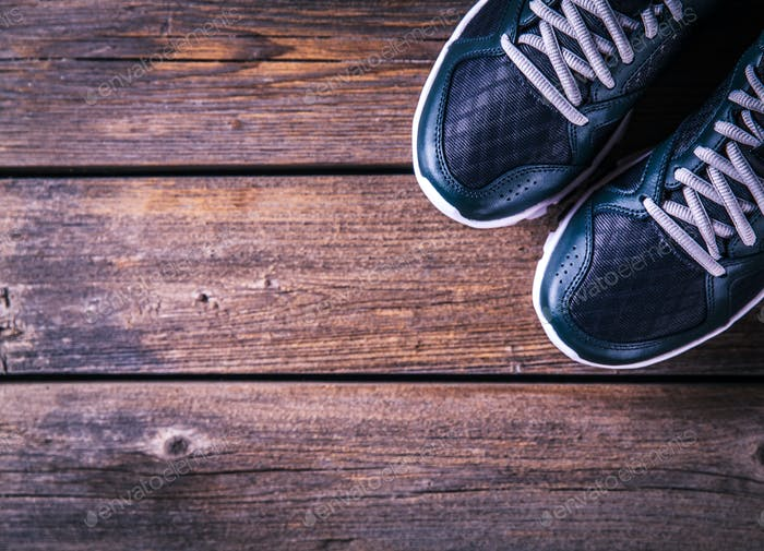 running shoes on a wooden background. sport