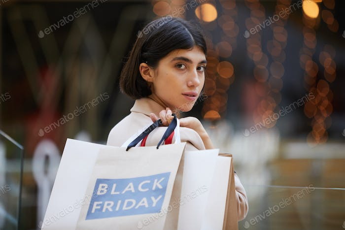 Portrait of Beautiful Woman Holding Shopping Bags