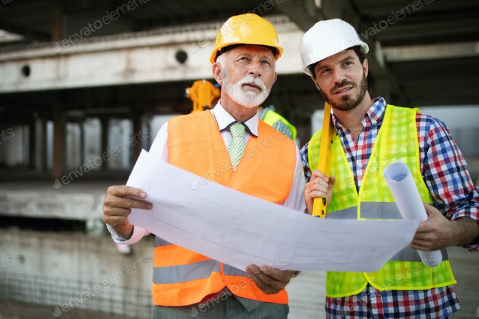 Group of construction engineer working in construction site