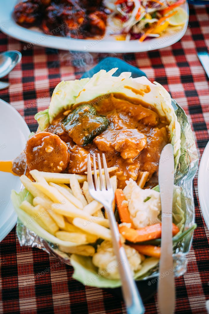 Goa, India. Dish Of Indian National Cuisine Is Sizzler, Which Consist Of French Fries, Fried Shrimp