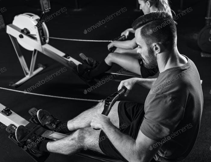 Cross training. Rowing machine exercising