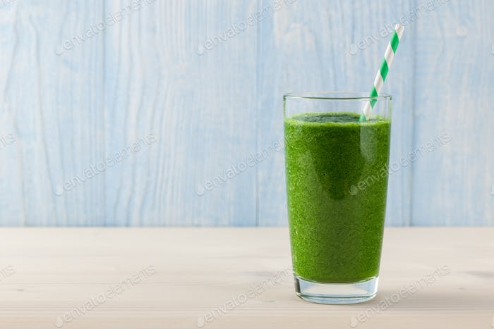 Fresh green smoothie on wooden table