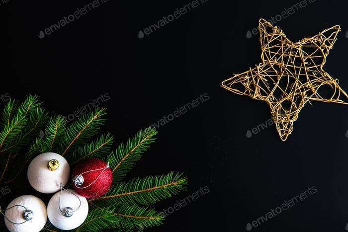 Round shaped Christmas tree ornaments isolated on black