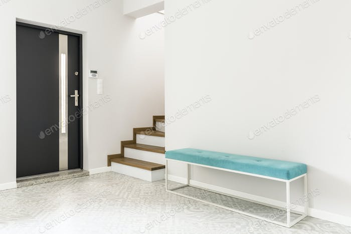 White entrance interior with bench