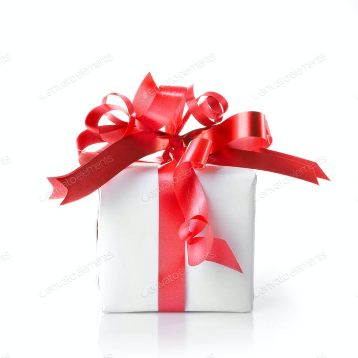 Holiday gift with red ribbon isolated on white