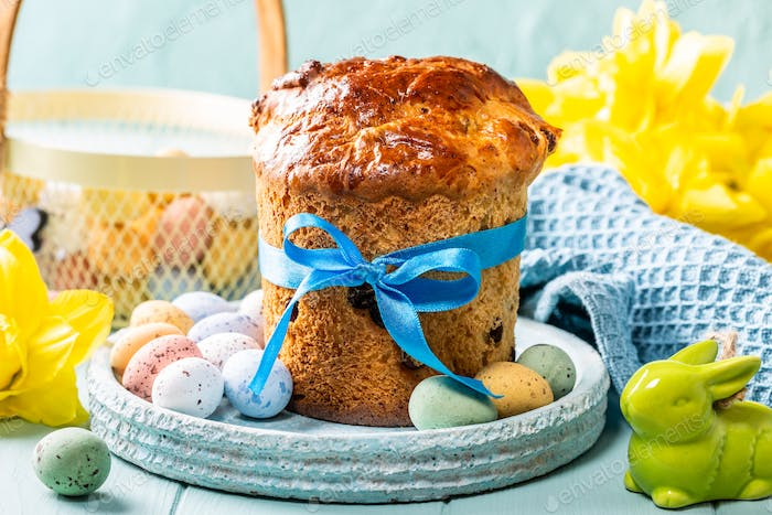 Easter orthodox sweet bread, kulich and colorful quail eggs