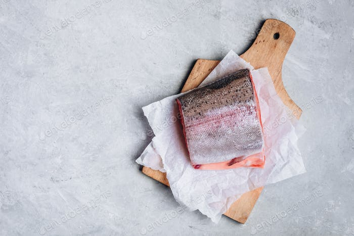 Fresh raw salmon or trout  for cooking on gray background.