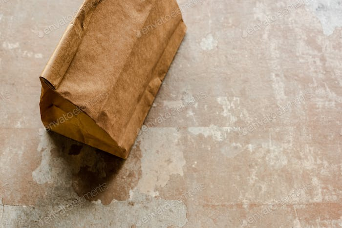 Brown Paper Bag on Weathered Surface