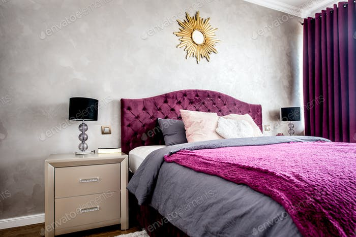 Interior of purple beautiful, cozy and stylish bedroom, with drapes and nightstands