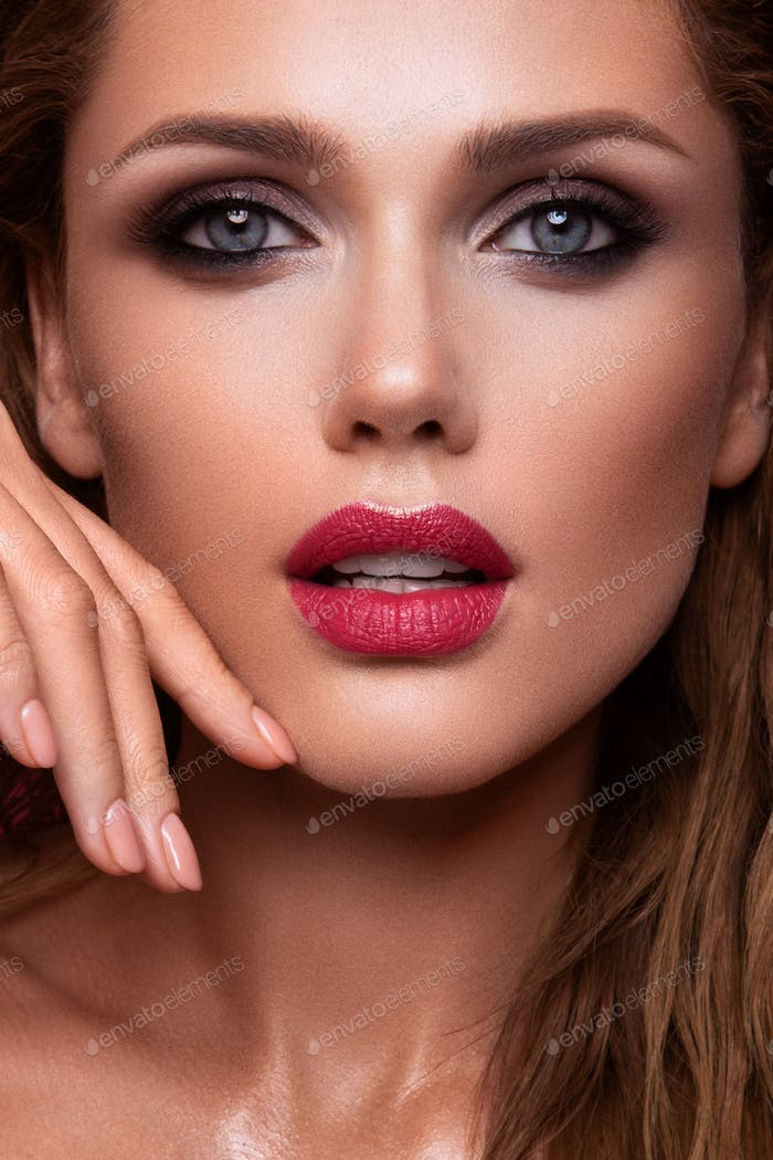 Portrait of beautiful girl with pink lips