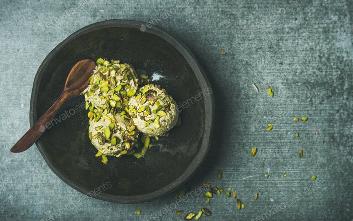 Homemade pistachio ice cream with crashed nuts, copy space