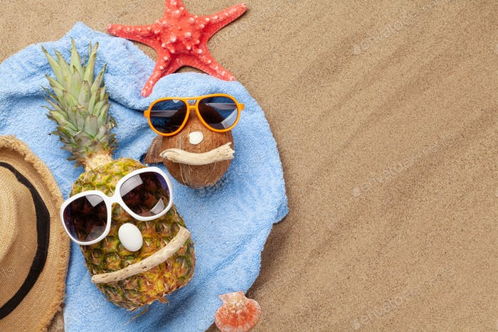 Ripe pineapple and coconut with sunglasses