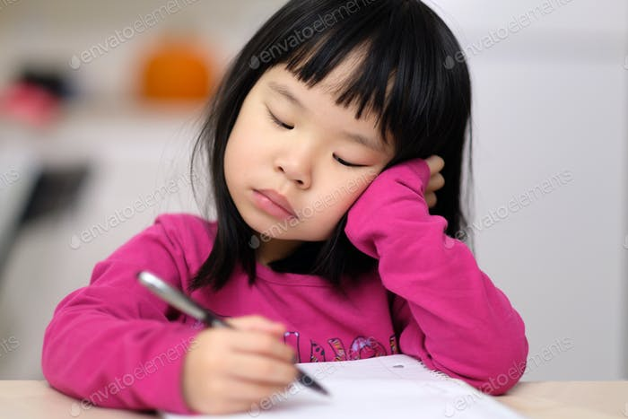 Early childhood education concept with little girl learn to write