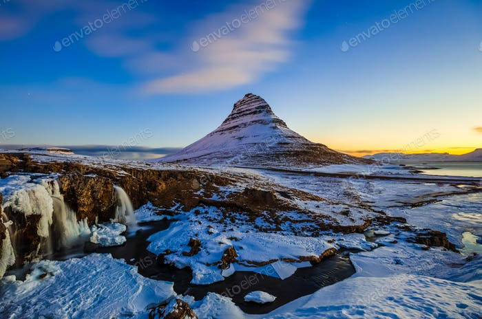 Kirkjufellsfoss Waterfall with Kirkjufell mountain at sunrise, Iceland