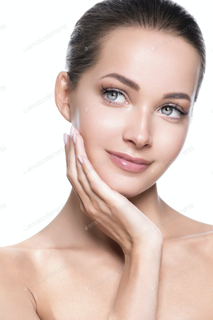 Beautiful woman face healthy skin and hair natural makeup beauty eyelashes with hands