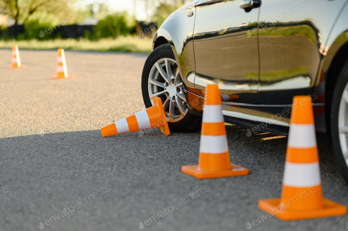 Car and downed cone, driving school concept