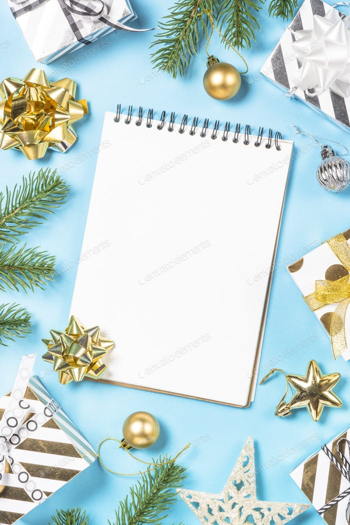 Christmas flatlay background - silver and gold decorations on bl