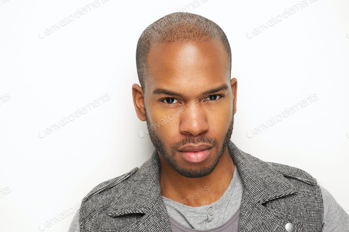 Attractive young black man against white wall