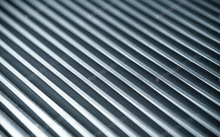 Fluted metal surface next to a control panel