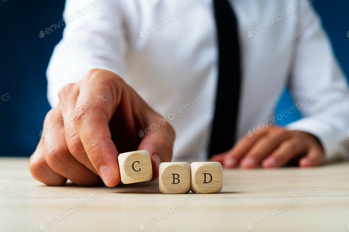 CBD sign on wooden dices