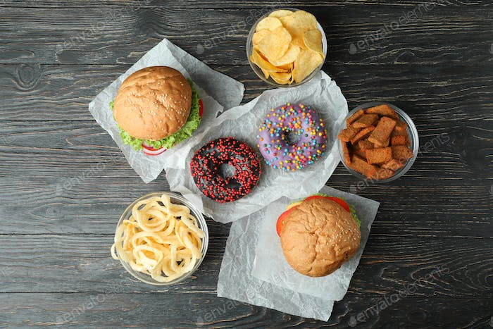 Tasty fast food on rustic wooden table