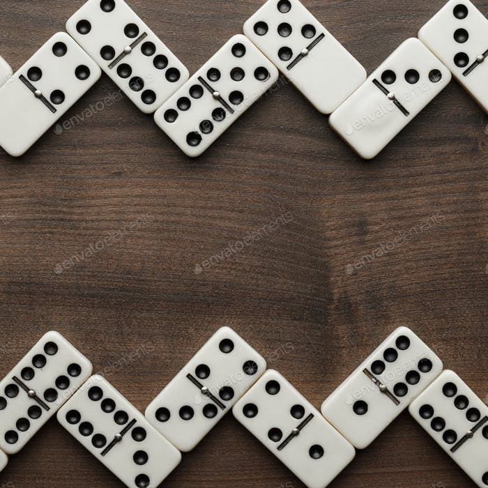 Domino Pieces On The Wooden Table Background