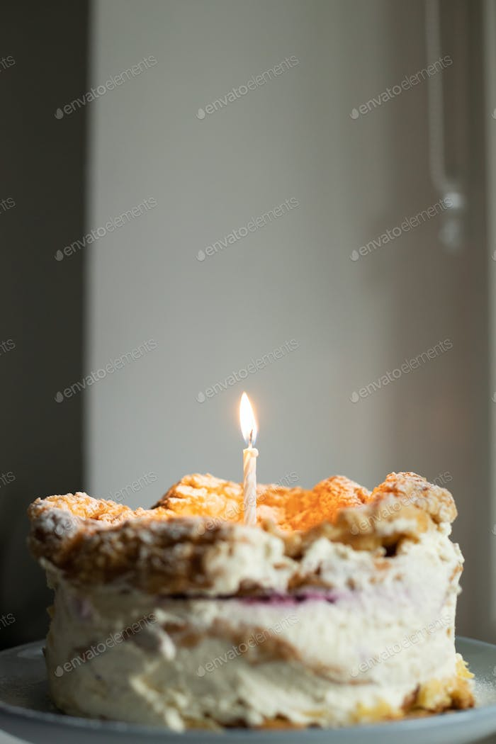 Homemade Birthday Cake with Candle.