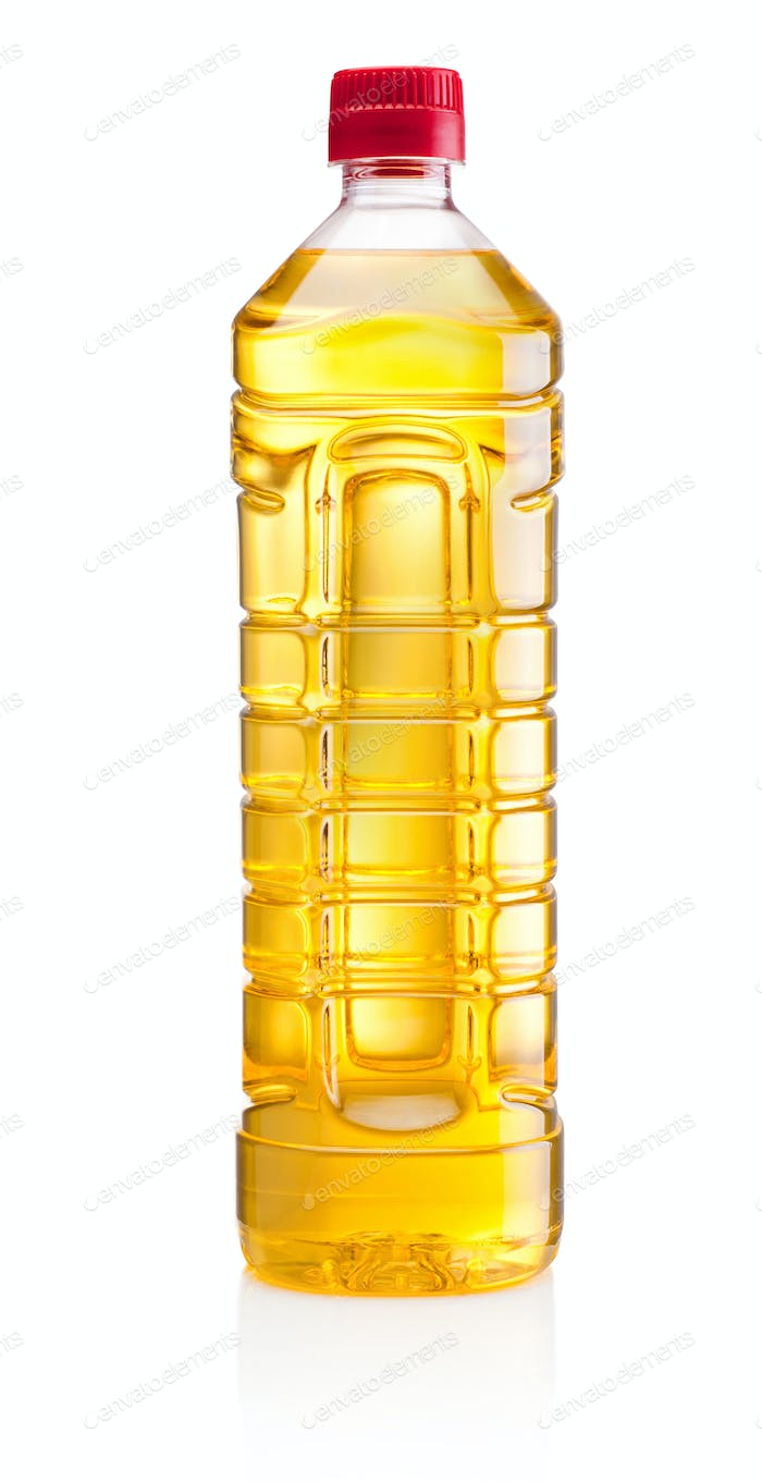Vegetable or sunflower oil in plastic bottle isolated on white b