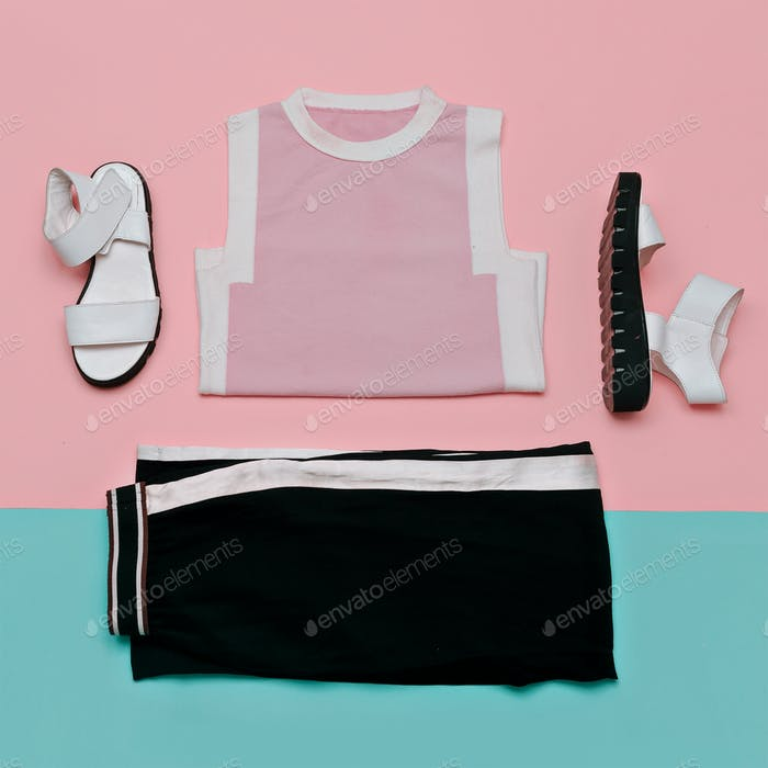 Flat lay fashion set: white sandals shoes, black striped trouser