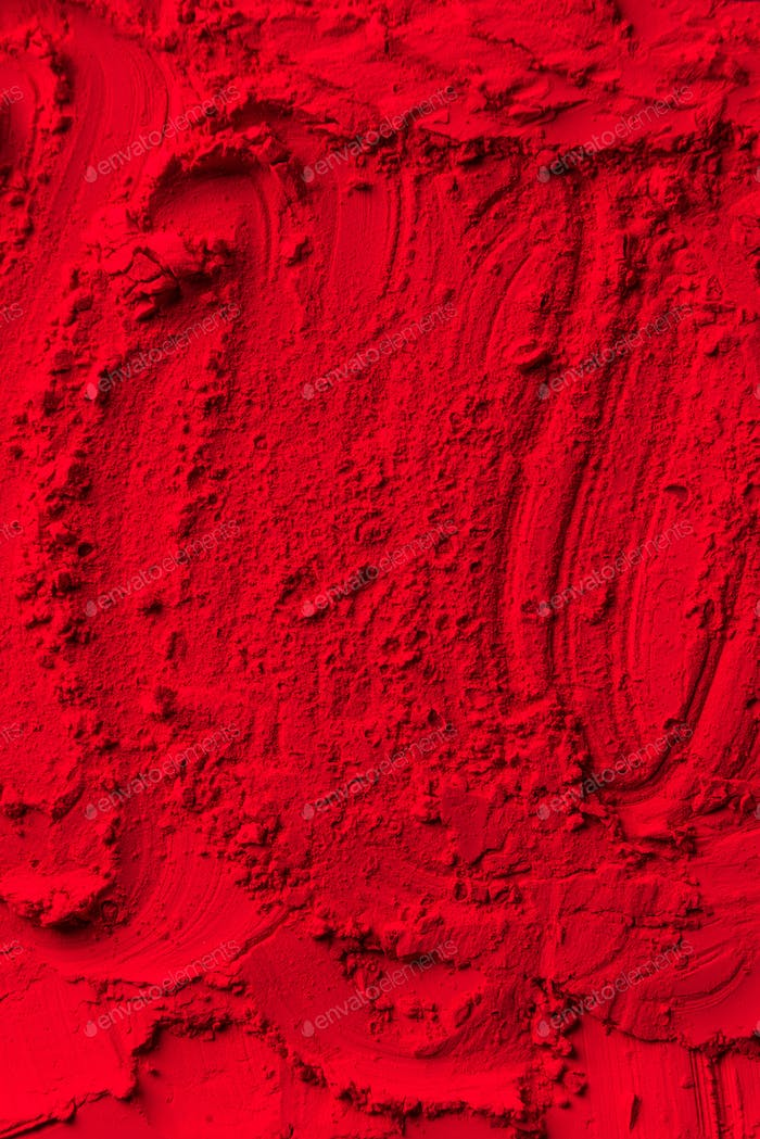 elevated view of red powder background