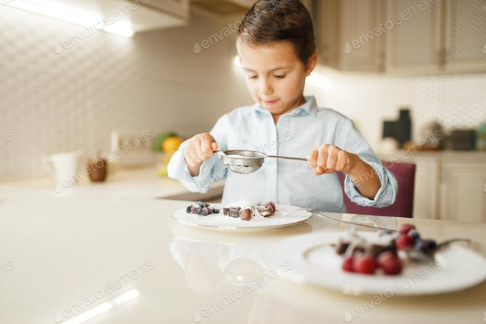 Young boy shows sandwiches with melted chocolate