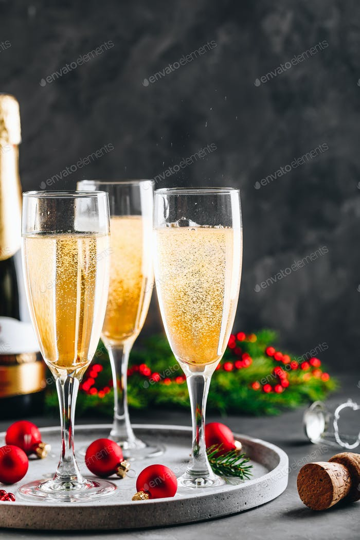 Glasses of champagne or prosecco. Christmas and New Year holidays background.