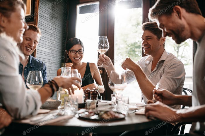 Young man with friends at restaurant