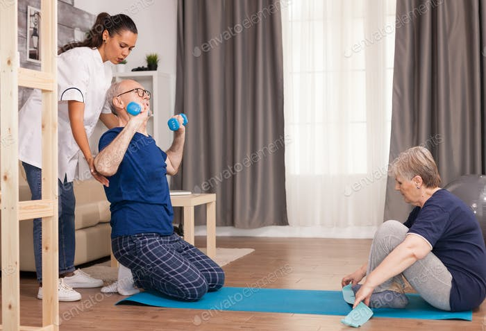 Elderly people doing sports with physiotherapist