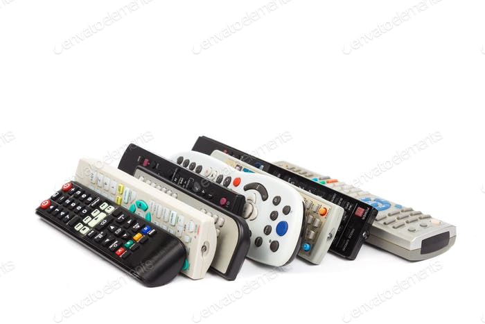 Stack of audio video remote control device in white background