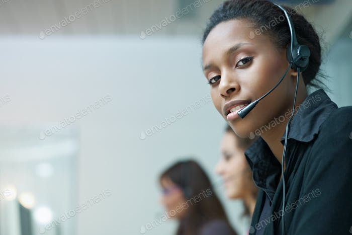 Portrait Of Black Woman Working As Customer Care Operator In Call Center