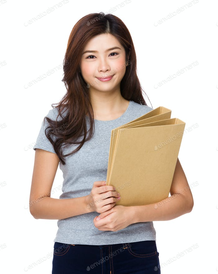 Asian businesswoman holding of files