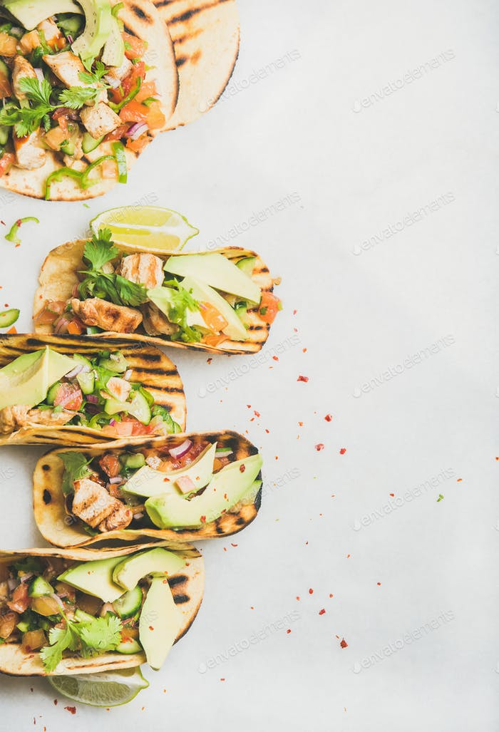 Allergy-friendly healthy corn tortillas with grilled chicken fillet, avocado, lime