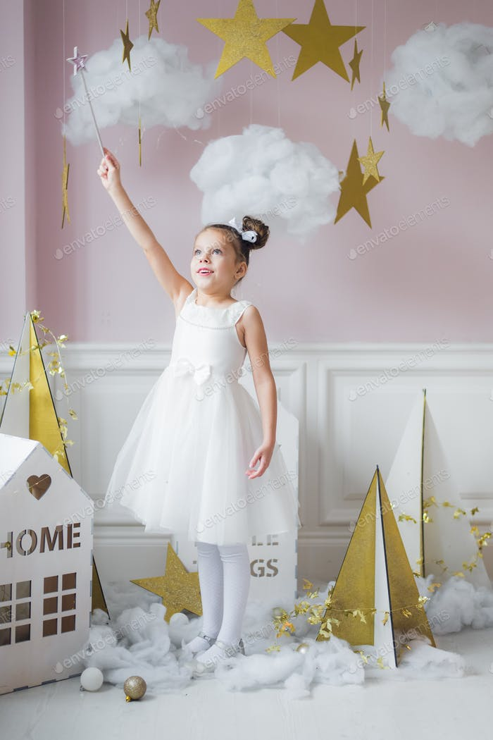 Little happy fairy or angel with magic wand on Holiday theme. Portrait of pretty caucasian little