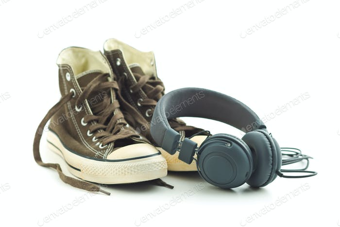 Vintage sneakers and headphones.