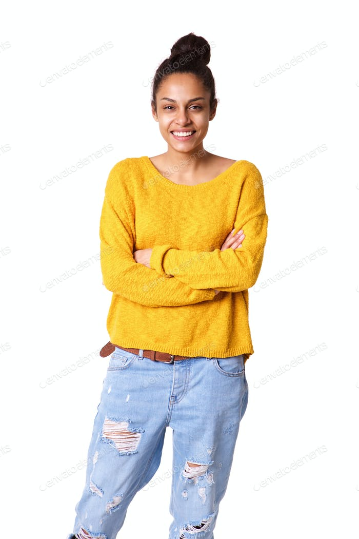 Happy young woman standing with her arms crossed