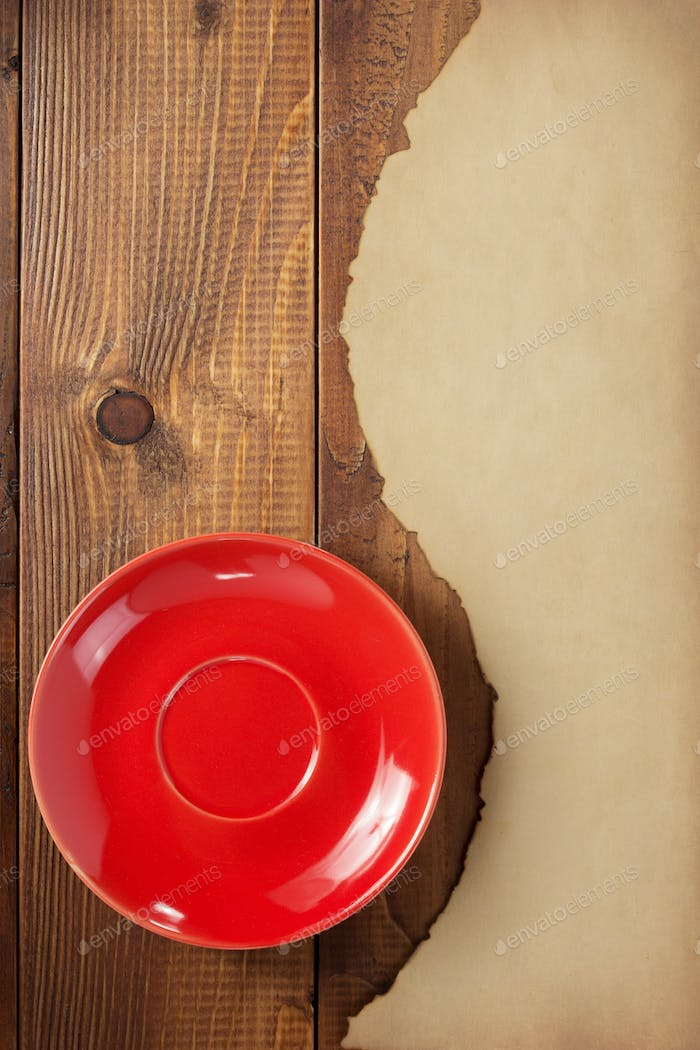 red saucer and old retro aged paper