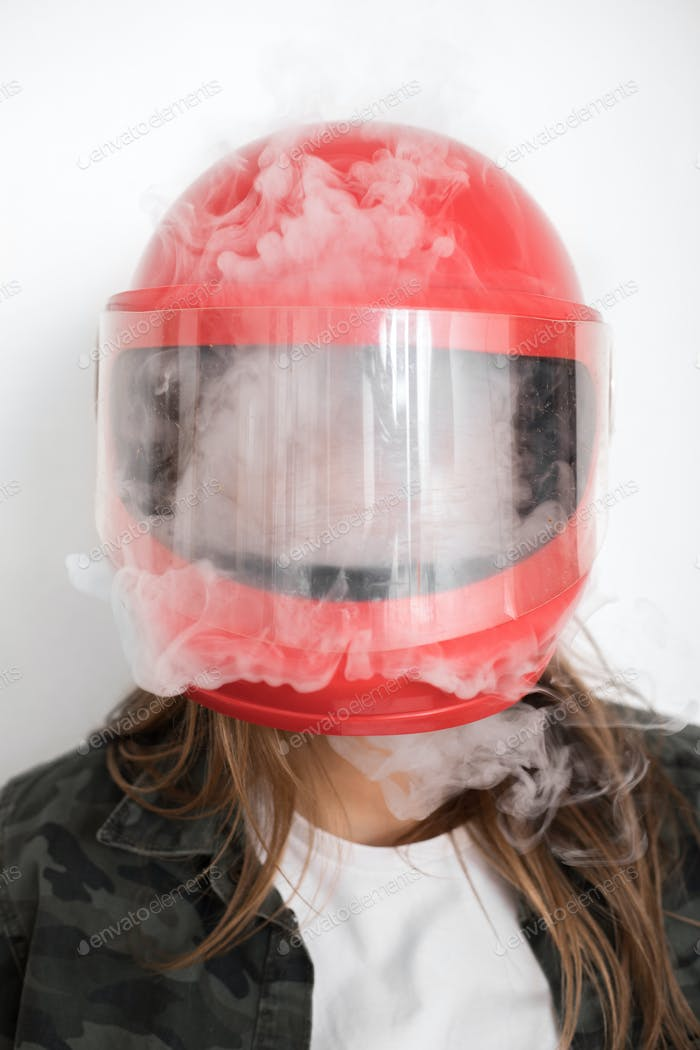 woman vapes inside the red helmut