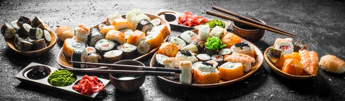 Set of traditional Japanese food sushi with soy sauce and ginger.